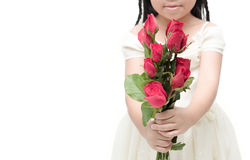 Red rose bouquet in little hand girl isolated royalty free stock photos