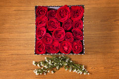 Red rose in box. Red rose in black gift box on wood table Royalty Free Stock Photography