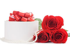 Red rose with a box with a gift Stock Images