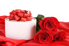 Red rose with a box with a gift Royalty Free Stock Image