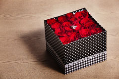 Red rose in box with ring. Red rosewith ring in black gift box on wood table Stock Photography