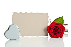 Red rose with  box in the shape of a heart Stock Photos