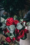 Red rose in brides flower bouquet. Fow wedding made by florist Stock Photography