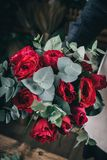 Red rose in brides flower bouquet. Fow wedding made by florist Royalty Free Stock Photo
