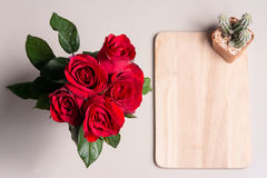Red rose and cactus on a board. For valentine day wallpaper Stock Image