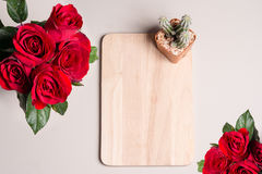 Red rose and cactus on a board. For valentine day wallpaper Stock Photo