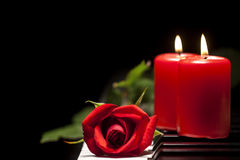 Red Rose and Candle on Piano Keys Royalty Free Stock Images