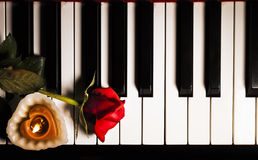 Red Rose and Candle on Piano Keys Stock Photography