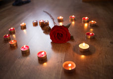 Red rose and candles Stock Photography