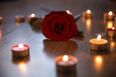 Red rose and candles Royalty Free Stock Photography