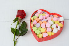 Red Rose and Candy Hearts Stock Photo