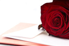 Red Rose and Card. Red rose, a card and envelope on white background Royalty Free Stock Images