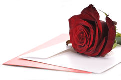 Red Rose and Card. Red rose, a card and envelope on white background Stock Photography