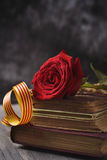 Red rose, catalan flag and old books Stock Images