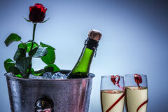 Red rose and champagne in ice cold Stock Photography