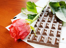 Red rose and chocolate Stock Photos
