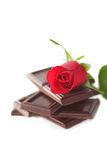 Red Rose with chocolate. On white stock images