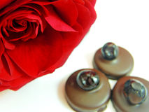 Red rose and chocolate cherry bonbons Royalty Free Stock Photos