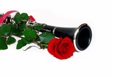 Red rose clarinet. Beautiful red rose and clarinet composition over white stock photos