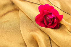 Red rose on cloth. Vintage style. Stock Photos
