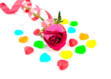 Red rose with colorful heart shape jelly candy on white backgrou Royalty Free Stock Photos