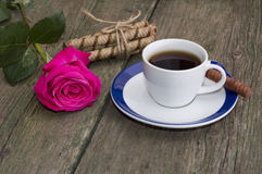 Red rose, cup of coffee and linking of cookies Stock Photography