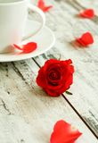 red rose and cup on old wooden Royalty Free Stock Photo