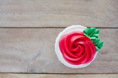 Red rose cupcake on table Stock Photos