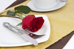 Red rose and cutlery on white plate. Valentine Series, Red rose and cutlery on white plate stock image