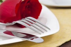 Red rose and cutlery on white plate. Valentine Series, Red rose and cutlery on white plate stock images