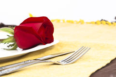 Red rose and cutlery on white plate. Valentine Series, Red rose and cutlery on white plate royalty free stock photos