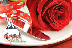 Red rose and cutlery on white plate. Closeup of red rose and cutlery on white plate Royalty Free Stock Photos