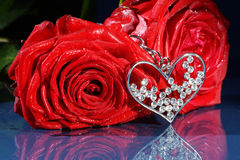 Red rose decorated with jewelry Royalty Free Stock Image