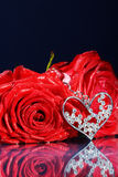 Red rose decorated with jewelry Stock Image