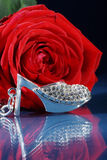 Red rose decorated with jewelry Royalty Free Stock Photo
