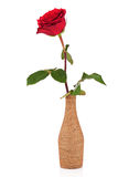 Red rose in decorative vase isolated on white background. Stock Photos