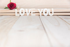 Red rose and diamond ring Royalty Free Stock Image
