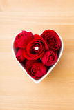 Red rose and diamond ring inside heart shape bowl Royalty Free Stock Photo