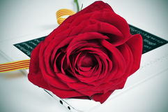 Red rose and e-book, for Saint Georges Day in Catalonia, Spain Stock Photo
