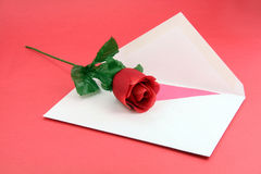 Red rose and envelope. Artificial red rose and envelope, Valentine's Day Stock Image