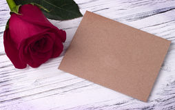 Red rose and and envelope for valentines day womens day greeting card. Red rose and and envelope for valentines day womens day greeting card Royalty Free Stock Images
