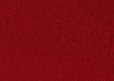 Red rose fabric. Red silk material with floral relief pattern Stock Photography