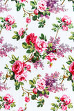 Red rose fabric background, Fragment of colorful retro tapestry text Royalty Free Stock Images