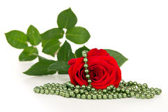 Red rose flower and beads Stock Photo