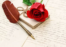 Red rose flower old letters antique feather pen Stock Images
