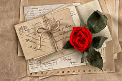 Red rose flower and old letters. vintage postcards and papers royalty free stock photography