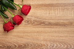 Red rose flower on wood Stock Images