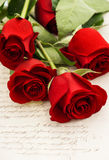 Red rose flowers and old love letters. Romantic vintage style background. selective focus stock photography