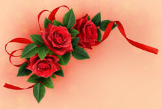 Red rose flowers and silk ribbon bow corner arrangement Royalty Free Stock Photography