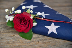 Red rose in folded flag Royalty Free Stock Photo